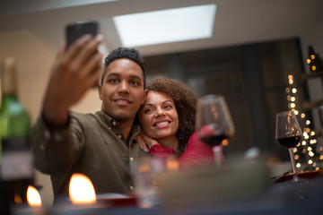 Couple taking a selfie at a celebration