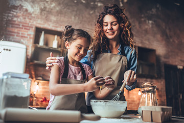 Mom with daughter on kitchen.