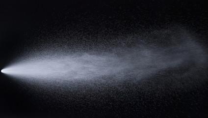 Water jet spraying on black background