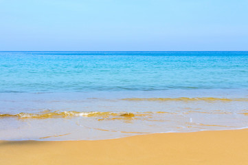Soft Wave Of Blue Ocean On Sandy Beach. Background. Selective focus