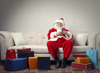 Santa Claus using technology
