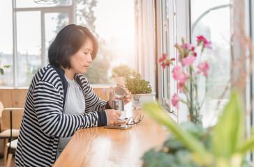 smart woman drinking black coffee in coffee shop