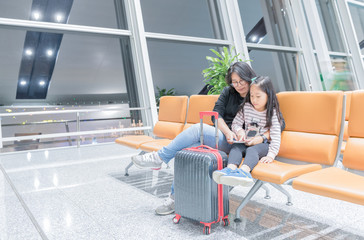 Mother talk with her daugther in airport
