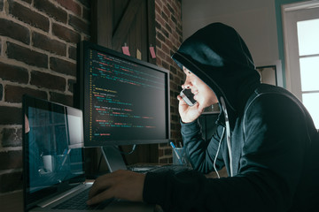 hacker using mobile smartphone calling for victim - fototapety na wymiar