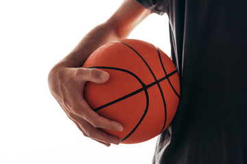 Basketball training, man holding ball