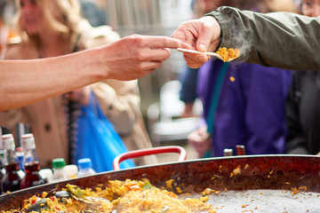 Sample of paella food on a fork at a market in Camden