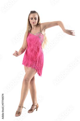 68c8e5f91 Gracious elegant feminine woman dancing rumba in pink costume. Full body  length portrait isolated on white studio background.