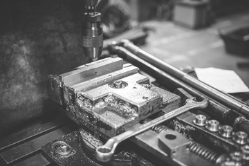 Vice and milling machine. Black and white image.