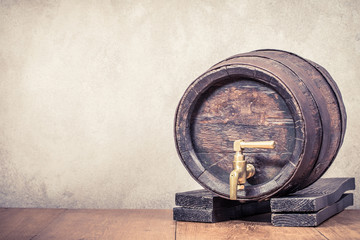 Old vintage aged oak wooden barrel. Retro style filtered photo