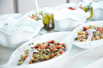 Vegetable  salads with olive oil  in white plates
