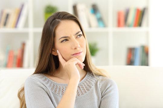 Woman wondering sitting at home