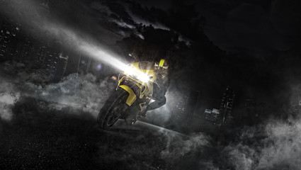 Supersport motorcycle rider driving at night