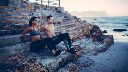 Adult Couple doing fitnessworkout at the beach