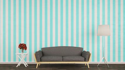 Sofa mit Lampe vor Wand im Wohnzimmer