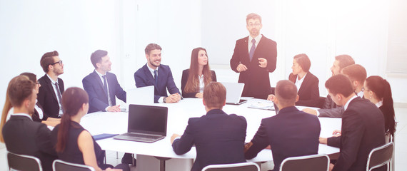 Director of the company discussing work problems at the meeting