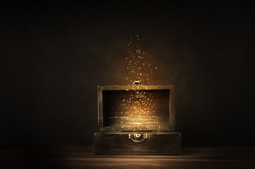 Opened Treasure Chest with Glowing Sparkles and Stars