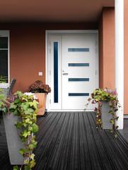Modern stone house entrance white door