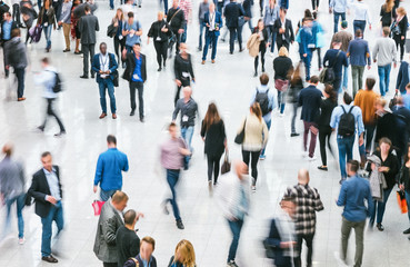 crowd of Blurred business people at a trade fair floor