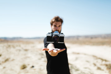 Man with camera over his hand