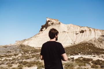 Man posing in desert