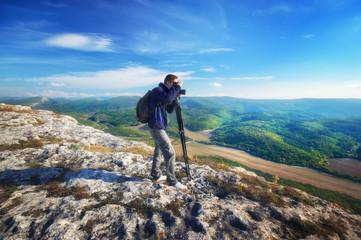 Photographer work in mountain. Job scene.