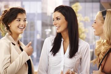 Female friends talking outdoors