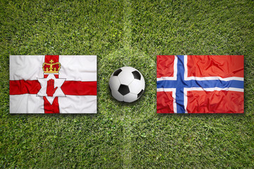Northern Ireland vs. Norway flags on soccer field