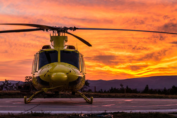 Printed kitchen splashbacks Helicopter Helicopter on a sunset