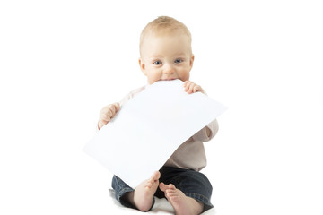 Infant child holding empty board, studio shot