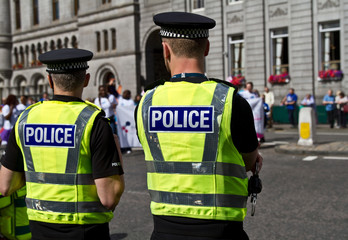 Police officers watching the crowd. UK Police