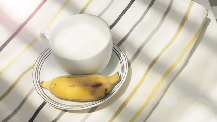 Cold milk and banana fruit breakfast has copy space