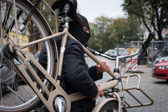 Theft wearing a balaclava stealing a bicycle