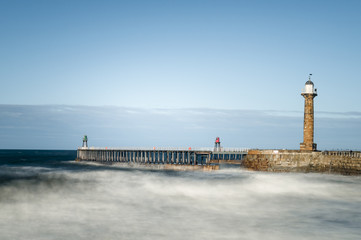 Whitby Harbour West Pier with heavy seas comming in, Yorkshire, England