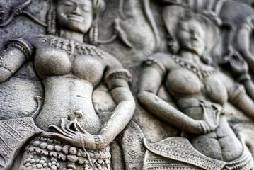 Carvings at Angkor Wat temple, formerly a Hindu temple, now Buddhist