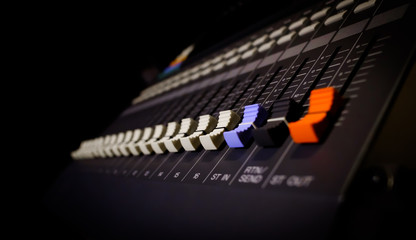 sound mixer fader, shallow dept of field. recording concept. music background