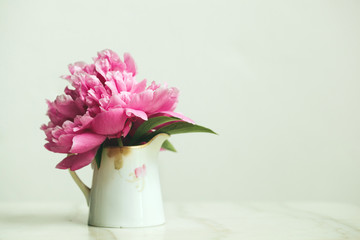 pink peony in an antique creamer