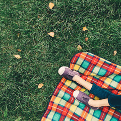 Picnic rug (and legs) on an early autumnal day