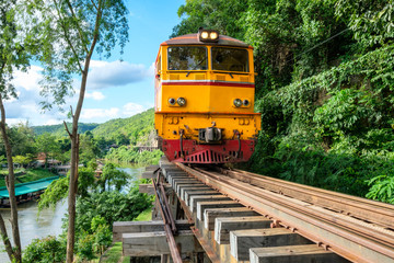 Ancient train running on wooden railway in Tham Krasae