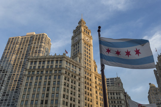 Wrigley building in downtown Chicago with city flag