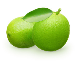 Whole fresh lime fruit with green leaf next to lying