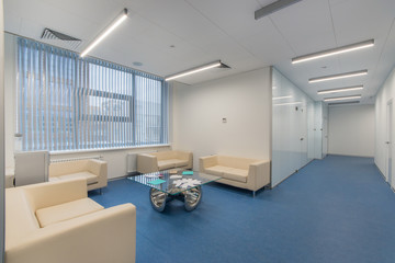 Clinic waiting area with seats and cooler