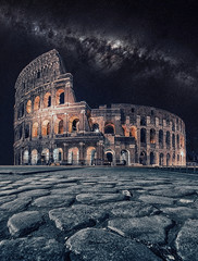 The Colosseum under the milky way in Rome