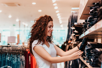 Picture showing happy woman shopping for clothes.