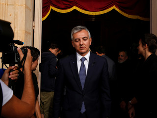 Former Opposition leader Simon Busuttil leaves after a Mass celebrated by Archbishop of Malta Scicluna for assassinated investigative journalist Daphne Caruana Galizia, at the Church of the Holy Family in her home village of Bidnija