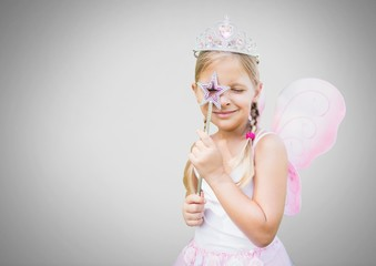 Girl against grey background with fairy princess costume