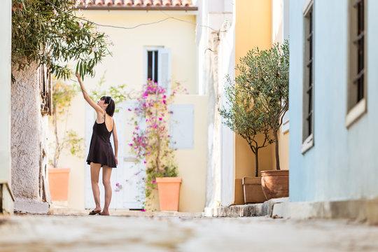 Woman exploring architecture of Plaka, Athens, Greece