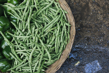 Green beans on sale at a food market in Asia.