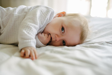 Portrait of baby lying in bed