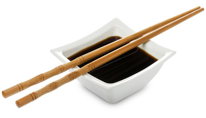 Square bowl of soy sauce isolated on white background