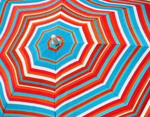 red and blue striped sun umbrella background